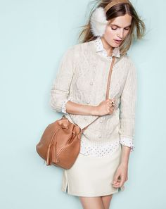 DEC '15 Style Guide: J.Crew women's Collection Italian cashmere cable sweater with pom-poms, perfect shirt in foil dot, double-notch mini skirt, Toscana shearling earmuffs and tassel-tie bucket bag.