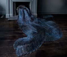Kate McCgwire making beautiful, undulating forms from feathers. Swoon.