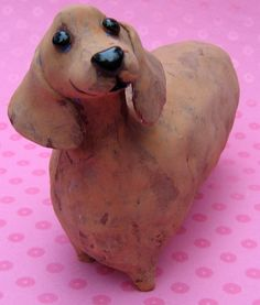 Fat dachshund ceramic dog sculpture by Karen Fincannon,