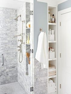 Shower Helper - Open shelves provide easy access to needed items and are cleverly tucked into a sliver of space between the shower and a wall. Baskets corral like belongings, and labels on each shelf ensure everything goes back to its rightful place.