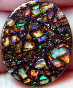This Opal looks like a stained glass window #Opals #Gemstones …