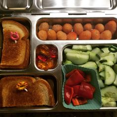 Wednesday's @planetbox lunch for my #4thgrader is organic grilled cheese sandwich, sunshine raspberries, local cucumbers and mini bell peppers, and Annie's fruit snacks. #peanutfree #peanutallergies #planetbox #9yearold #rockthelunchbox