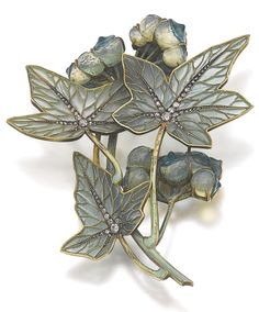 An Art Nouveau enamel, glass and diamond jewel, Lalique, circa 1900. Designed as stylised white bryony, the leaves decorated with plique-à-jour enamel, circular-, single-cut and rose diamonds, the berries in glass, signed Lalique, later brooch fitting. #ArtNouveau #Lalique #brooch