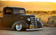 Pre-War Chevrolet pickup truck in satin black and slammed over some sweet chrome steel wheels and wide white walls. This is just a classic and clean 1938 Chevy