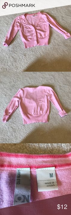 Pink Old Navy girls cardigan size M Old Navy girls pink crop cardigan. V neck, buttons halfway up. Size Medium. In excellent gently used condition no tears, rips or stains! Old Navy Shirts & Tops Sweatshirts & Hoodies