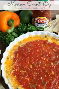 This Mexican sunset dip is a tasty mix of cheese, green chilies, Mexican chorizo, and salsa. It is such a simple recipe to make for parties. #StockUpOnPace  #Safeway #ad
