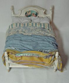 Dolls house miniature Blue Untidy Bed. £65.00, via Etsy.