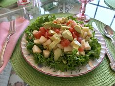 Start with a bed of your favorite lettuce.  I like to use the curly leaf lettuce, because it makes such a pretty edge. Then layer with:  pear apple banana pink or red grapefruit avocado  You can vary the fruit, but it's the red or pink grapefruit and the avocado that will give your salad the pretty color!   Dress with your favorite strawberry or raspberry vinaigrette.    My grocery store has several berry vinaigrettes to choose from. Enjoy!