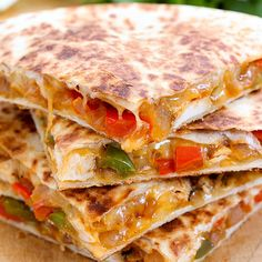 Chicken Fajita Quesadilla combines two of my favorite things: Fajitas & Quesadillas! This is an easy recipe for a cheesy chicken quesadilla made in minutes!