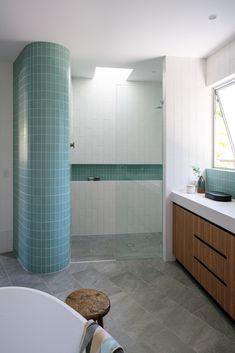 This modern bathroom features turquoise tiles that wrap around a curved wall, while white subway tiles have been laid vertically, drawing your eye upwards to the small skylight in the shower. Bathroom Design Luxury, Modern Bathroom, Hall Bathroom, Beautiful Bathrooms, Barbacoa, Brisbane Architects, Turquoise Tile, Small Outdoor Spaces, White Subway Tiles