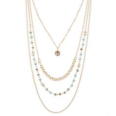 A bright crystal bead centers a cool layered necklace that combines multicolored beads with a glistening gold-tone chain for a polished boho-chic look.