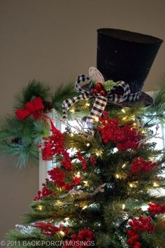 top hat tree topper this is what i did for my christmas tree with black white green and red whimsical decorations mine is a 9 ft white tree though - Top Hat Christmas Decorations