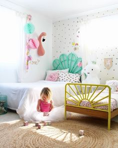 Girls bedroom ideas - a fun and whimsical shared bedroom space for my toddler and my tweens. More pics and kids room ideas on the blog.