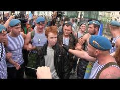 A violent group of Russian Paratroopers harassing and threatening a young lone gay activist. Disgusting.