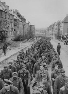 The long, endless procession of German POWs after the fall of Aachen. October 1944.