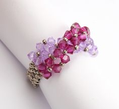 Swarovski ring with ripples (Czech) this just right w/ golden mauvey and deep maroon-ishy-purpley tones.brassy browny purple
