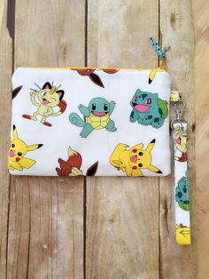 Pokemon wristlet purse, zippered wallet pouch by PopThree on Etsy https://www.etsy.com/listing/467117279/pokemon-wristlet-purse-zippered-wallet