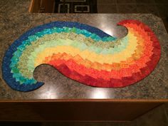Spicy spiral table runner in rainbow colors