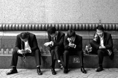 Beatles  #people #suit #man #smartphone #black_and_white #street #shanghai #blackandwhite The guys in black suits are using phones by their own ways. -- Your Shot. NATIONAL GEOGRAPHIC.