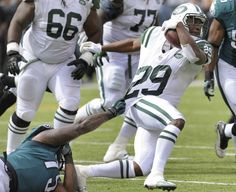 New York Jets running back Bilal Powell (29) is brought down by Philadelphia Eagles defensive end Vinny Curry (75) during the second quarter of an NFL football game, Sunday, Sept. 27, 2015, in East Rutherford, N.J. (AP Photo/Bill Kostroun)