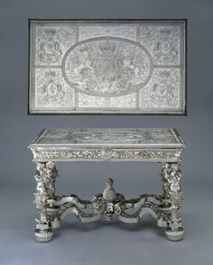 Andrew Moore (1640-1706) Designed by Daniel Marot - Side table Top detail Andrew Moore (1640-1706) - Side table solid silver legs support an oak tabletop, overlaid with thick sheets of silver, bearing the marks of Andrew Moore (1640–1706), a silversmith from Bridewell in the City of London. The table is thought to have been made to a design by Daniel Marot (1661–1752), who also worked as a chief designer for William III at Hampton Court Palace.Silver