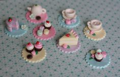 Fondant Tea Party Toppers with Teapot, Teacups, Macaroons, Cupcakes, Cookies and Cakes for Decorating Cupcakes, Cookies. $25.00, via Etsy.