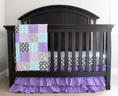 This purple ruffle crib skirt is too sweet! This crib bedding is a fab mix of pattern and color in a baby girl nursery {bedding from @gigglesix}