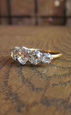 Antique Victorian diamond five stone engagement ring in gold, from Doyle Doyle. Click to see more antique diamond rings!