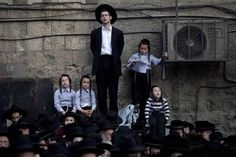 Thousands of Ultra-Orthodox Jews joined an early-morning prayer rally in Jerusalem on Monday to protest against government moves which could bring to an end the exemption of yeshiva studentsfrom mandatory military service.  The Israel