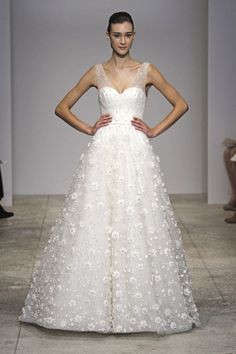 tulle v-neck ballgown with sheer neckline and natural waist. skirt features delicate floral and crystal embellishment.