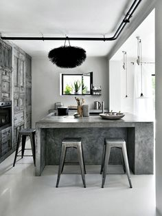 Love Tricks chair and concrete island kitchen ,from Elle online
