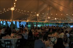 We created this custom cafe bistro lighting concept in a 40x100 tent for this Madison Georgia wedding