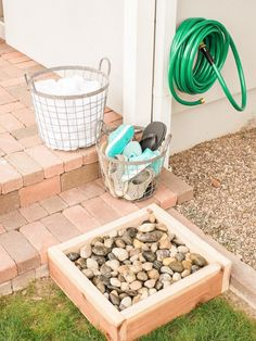 Build a simple foot-washing station near your back door to keep sandy and muddy feet off of clean floors.