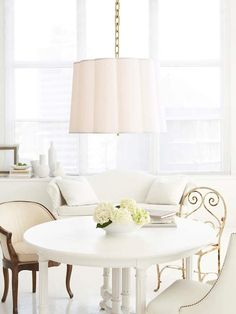 Again, I am a sucker for white. Barbara Barry's scalloped pendant makes a beautiful statement over the breakfast table. Love the mis-matched chairs.