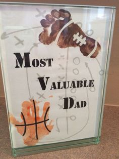 """Fathers day gift, football footprint and basketball handprint: """"Most Valuable Dad"""""""