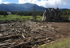 Trees and debris washed up to the St. Catherine of Siena Chapel at the Saint Malo Center in Allenspark near Estes Park Monday Sept. 16, 2013, by the recent flooding.
