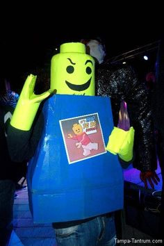 A Lego man salutes the camera during Guavaween 2012. This costume was homemade by the person behind it.