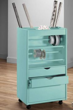 This is a cool DIY piece for storing gift wrap - using an old dresser (it seems), putting wheels on it, adding bars across empty drawer area, and the back open for rolls of wrap.