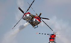 Indian Air Force helicopters cross paths while performing an aerobatic flight on the opening of the Aero India 2013 at Yelahanka air base in Bangalore. Indian Army Wallpapers, Indian Air Force, Wallpaper Free Download, Air Show, Armed Forces, Fighter Jets, Aviation, Aircraft, Military