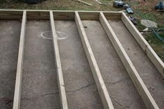 deck joists in progress--building a deck on top of existing patio