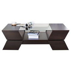 Found it at AllModern - Matias Coffee Table http://www.allmodern.com/deals-and-design-ideas/p/Top-Rated-Coffee-Tables-Matias-Coffee-Table~KUI4885~E22433.html?refid=SBP