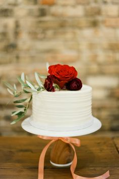 Romantic red floral topped cake: http://www.stylemepretty.com/minnesota-weddings/minneapolis/2016/05/26/this-couple-planned-the-ultimate-indoor-garden-party/ | Photography: Melissa Oholendt - http://melissaoholendt.com/