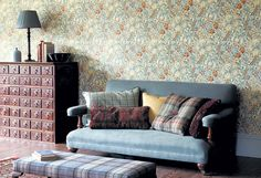 """William Morris prints were very big in the 1970s. Households up and down the country were gripped by the trend for co-ordinating wallpapers and fabrics. It wasn't enough to have a swirling floral print on the walls, to get the complete look you needed to cover your curtains, chairs and bedspreads in it, too. At its peak the Morris & Co fabric """"Golden Lily"""" was selling 5,000 metres a month in tasteful shades of brown and orange."""