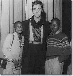 Elvis Presley with young fans at the WDIA Goodwill Revue Dec 6, 1957 Memphis Tn..Their father was renowned Memphis photographer Ernest C. Withers..