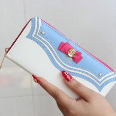 Grab your new Sailor Moon Wallet as you head out to run your errands, party with friends, or to go on your next date. The inside slots will hold all of your important cards as you keep all of your loo