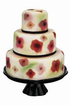 Three-tiered floral air-brushed cake £485 (serves 100), by Fancy Nancy