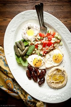 My Kind of Breakfast!!  Lebna, tomatoes/cucumbers/mint, eggs, kalamata olives, and humus with pita bread...doesn't get better than that!