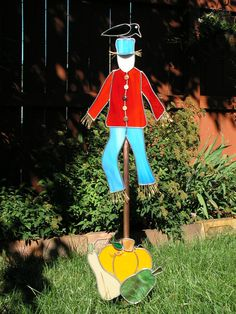 Saw this today and really liked it!   Scarecrow Yard Art Garden Stake with Pumpkin by PlateFlowersPlus, $125.00.