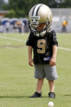 # 9 ,Saints QB Drew Brees' son stole the show at training camp ; ) He has time to grow into that helmet : )