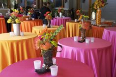 Love these bright colors (so IN right now!) with the whimsical cowboy boot centerpiece!  www.culinarycrafts.com